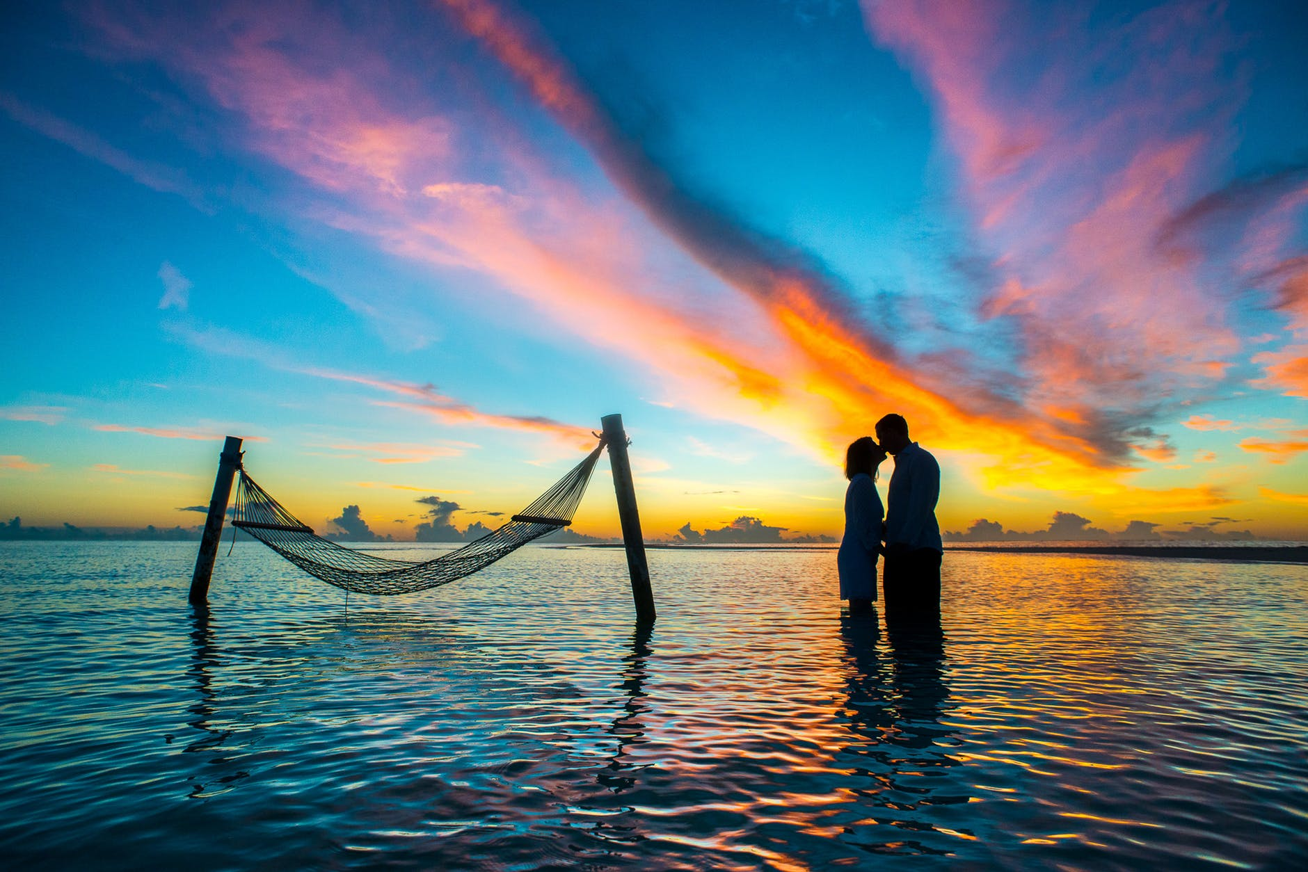 COUPLE AT THE SUNSET